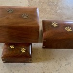 Handmade mahogany with brass paw print casket
